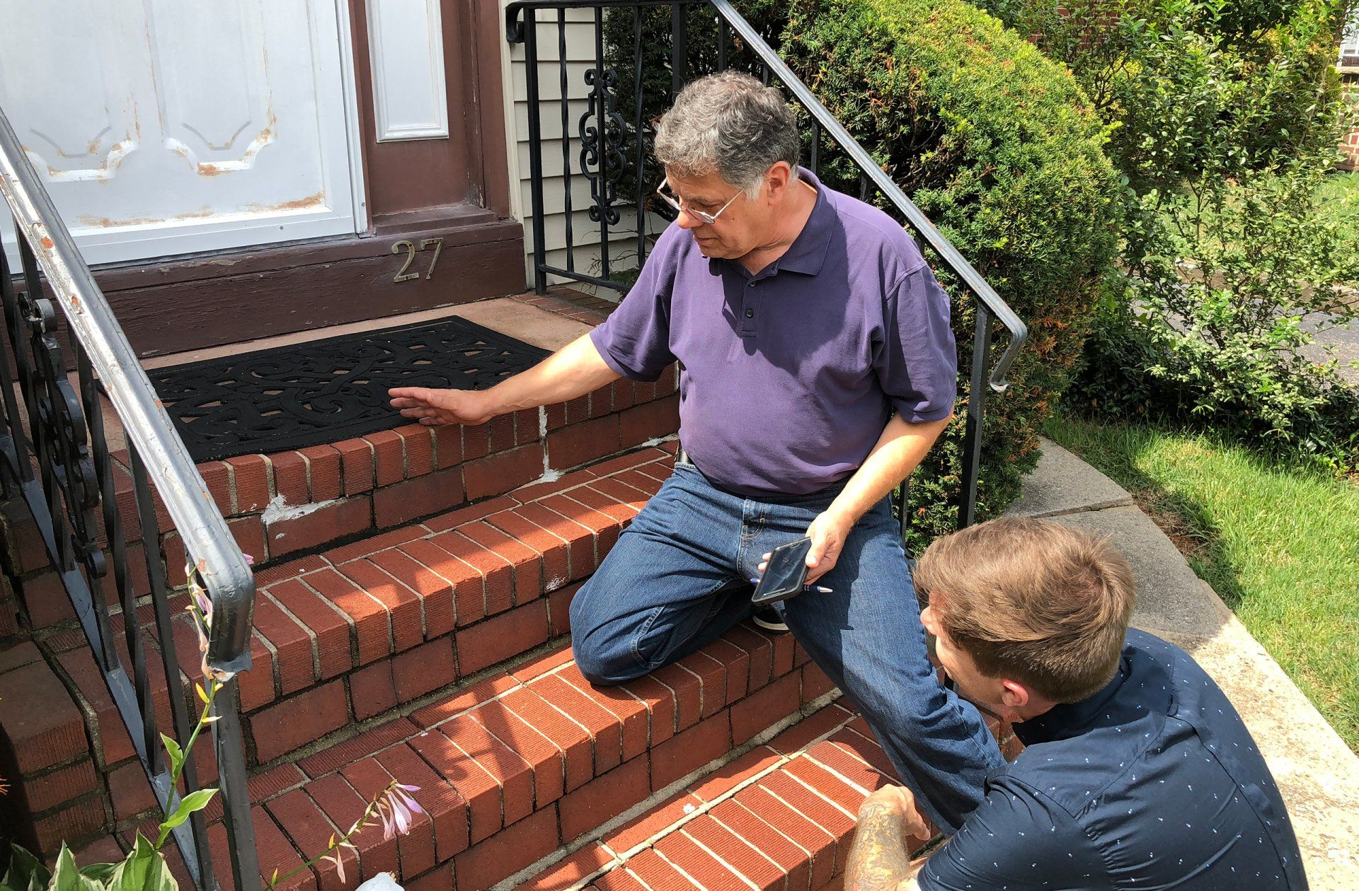 home inspector checking on steps