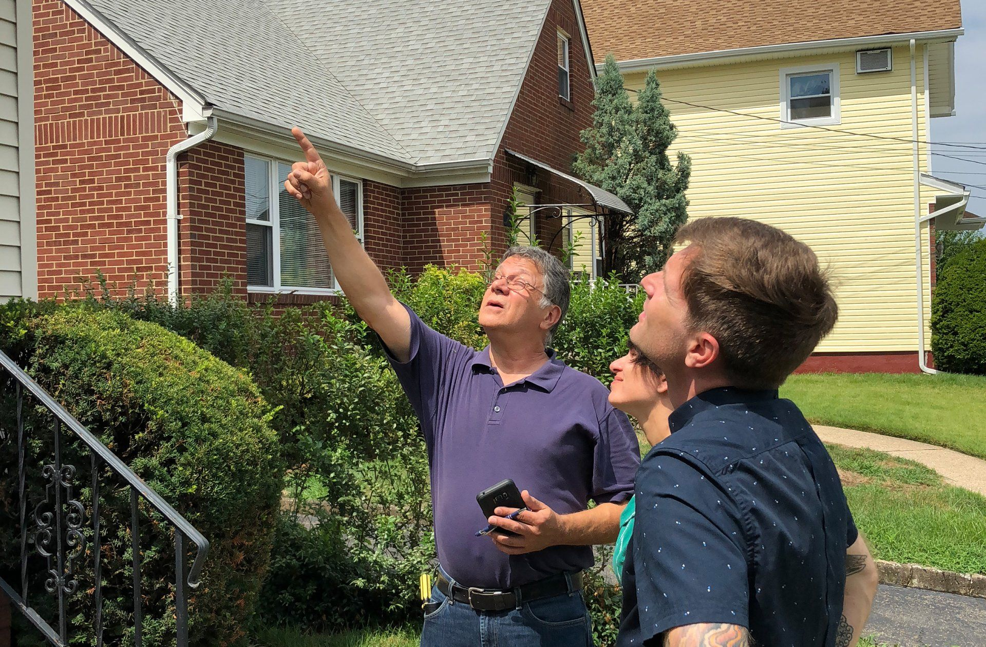 paul explaining home inspection to couple